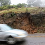A driver proceeds cautiously around fallen rock on Skyline Boulevard in Oakland. ANDREW LEONARD / CALIFORNIA BEAT PHOTO