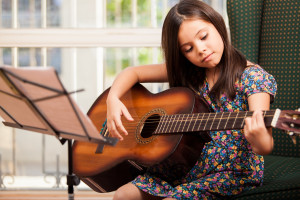 child-learning-guitar-chords