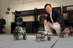Dr. Mo-Yuen Chow and robot cars used to simulate driving in his EB2 lab.
