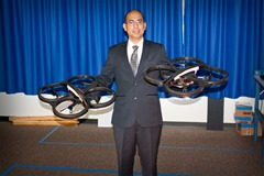 Dr. Edgar Lobaton with quadcopters used in his research and labs