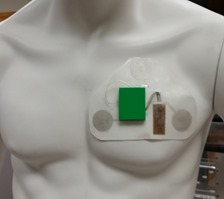Textile patch with ABS plastic shell containing circuitry for measuring ECG, PPG, wheezing, and motion.