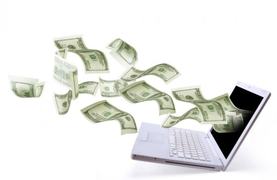 Money flying out of a laptop - making money online