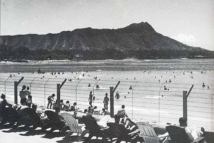 Waikiki Beach behind barbed wire fence, during martial law.  Honolulu, Hawaii. (Image: National Archives, U.S. Navy)