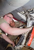 Airman 1st Class Jacob Bagley, an aircraft maintainer with the 407th Air Expeditionary Group, shows the mechanics of landing gear to Lt. Gen. Michael X. Garrett, the commanding general of U.S. Army Central, at Muwaffaq Salti Air Base, Jordan, April 22, 2016. The USARCENT command team met with leaders of partner militaries throughout USARCENT's area of responsibility to continue to build bilateral partnership ties.
