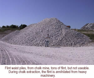Flint waist piles, from chalk mine, tons of flint, but not useable.   During chalk extraction, the flint is annihilated from heavy machinery.