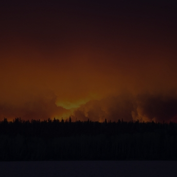 A massive wildfire rages Wednesday evening, May 4, 2016, near Fort McMurray.