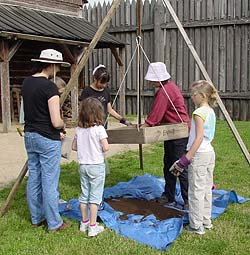 (NPS photo) Archeologists at Fort Vancouver NHP interpret archeology as they excavate with the public.