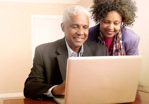 man and woman on laptop