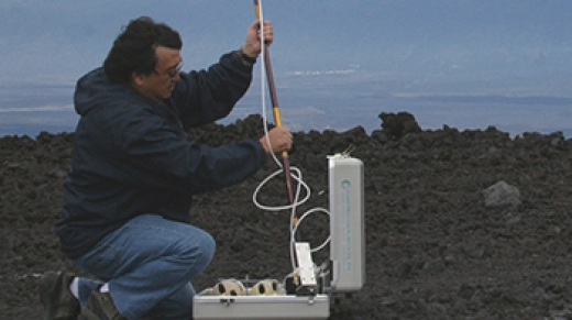 NOAA engineer Paul Fukumura-Sawada captures air near NOAA's Mauna Loa Observatory in Hawaii, using one of many methods to measure carbon dioxide and other greenhouse gases in Earth's atmosphere.
