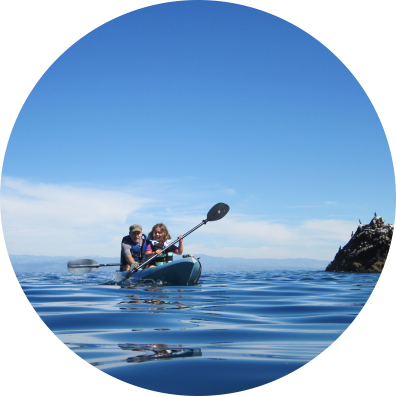 A father and daughter enjoy a kayak trip in NOAA's Channel Islands National Marine Sanctuary.