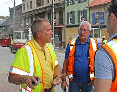 Steve O'Leary (left), U.S. Army Corps of Engineers, Huntington District architect, and Randy Behm, USACE, Omaha District engineer, discuss flood damage and flood-risk management options in Ellicott City, Maryland, Sept. 20, 2016. Marco Ciarla, USACE, Baltimore District engineer, is at right. A Howard County government official was also present. Ellicott City suffered a major flood in July 2016. O'Leary and Behm are members of the USACE National Nonstructural Flood Proofing Committee that assists communities nationwide with nonstructural flood-risk management. Examples of nonstructural measures include elevation and waterproofing of buildings, moving valuables to higher locations and flood-emergency preparedness. (U.S. Army photo by Sarah Gross)