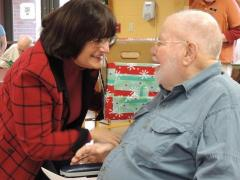 Rep Kuster talking with a citizen