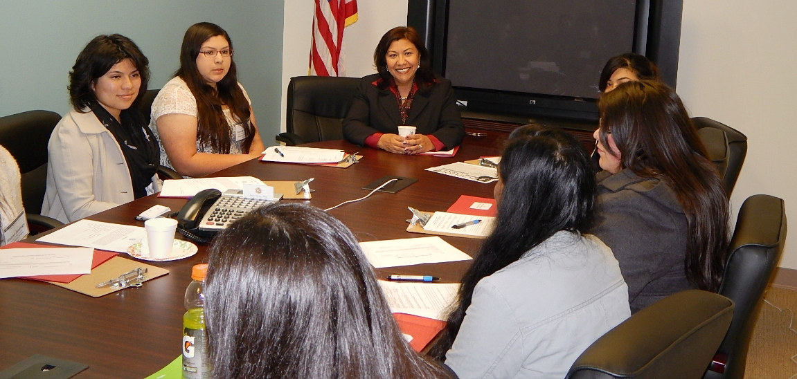 Former participants speak to Rep. Norma Torres