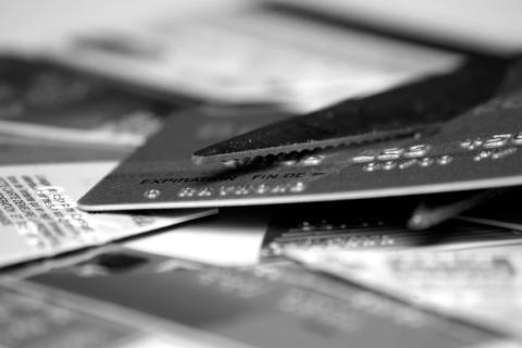 scissors cutting a credit card