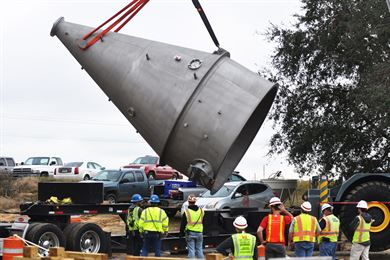 Workers unload four Speece cones delivered Dec. 14, 2016, to an Army Corps of Engineers site along the Savannah River. The Speece cones, each about 22 feet tall when installed, will dissolve pure oxygen into water extracted from the river, then push the water back into the river. The process will replace dissolved oxygen in the river lost as the Corps of Engineers deepens the harbor from its current 42-foot authorized depth to 47 feet.  The replacement of dissolved oxygen lost to the deepening of the Savannah River forms one of the environmental mitigation actions taken by the Corps for the Savannah Harbor Expansion Project (SHEP). Deepening the harbor will allow new, larger, more efficient container ships to call on Savannah's port with heavier loads and with fewer tidal restrictions.  These cones will be installed at a site across from the Port of Savannah. An additional set of Speece cones will be installed upstream of the harbor in Effingham County.