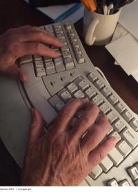 photo of elderly hands on a keyboard