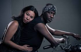 "Evelyn Chew plays biker chick to Carl Kennedy's gang guy in ""A Good Way Out"""