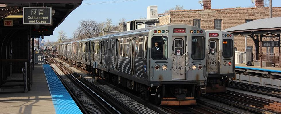 Two Chicago Transit Authority Red Line subway trains on platform