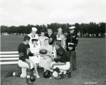 Original Caption: Military personnel with some of the members of the Chicago Bears Football team. In the group are George Blande, Cpl Jo Ruff, Cpl Sonia Schmit, Harry Jagade, fullback of the Bears; Larry Brink, and Pfc John Carbon, August 4, 1954. Local ID: 111-SC-464065