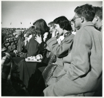 Original Caption: MSC Story. Football crowd eats hot dogs on a chill day. Local ID: 306-PS-515-S-50-12349