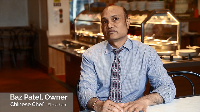 Local business owner Baz Patel, sitting in his restaurant looking concerned
