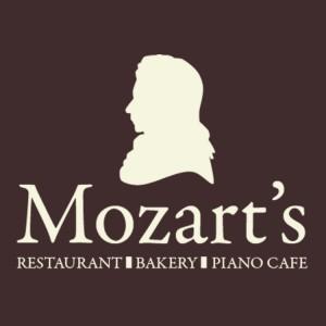mozarts logo white on brown