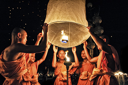 6 Monks holding lantern