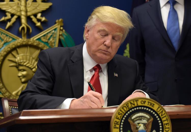 "During a signing ceremony at the Pentagon, Trump claimed the order would ""keep radical Islamic terrorists"" out."