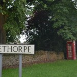 Village of Apethorpe, UK. Telephone booth is the local lending library.