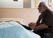 Images of Julian Scadden at the bedside of a dying Veteran.