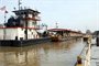 Ensley Engineer Yard and Marine Maintenance Center's Plant Section in operation. Motor Vessel Lusk and Motor Vessel Strong face up on both ends of the Revetment Mooring Barge 7401 removing it from dry dock 5801. (USACE Photo/Brenda Beasley)