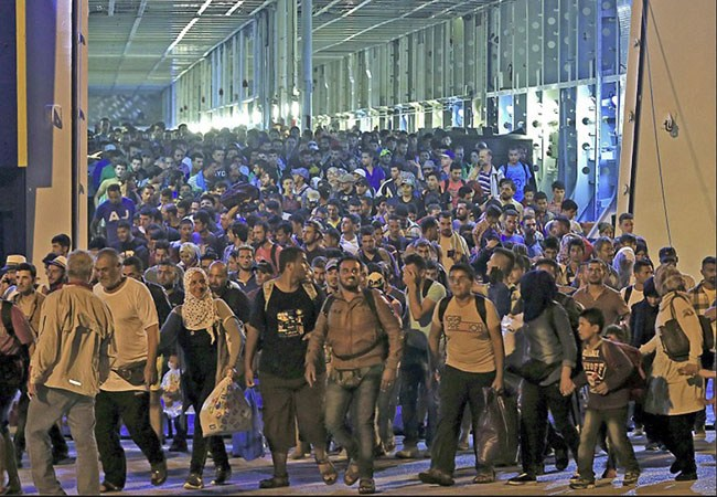 Nonwhite invaders pour into Greece from ships facilitated and paid for by the EU.
