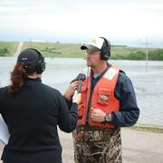 Image: USGS Scientist is Interviewed by Media at the Flooded Souris River
