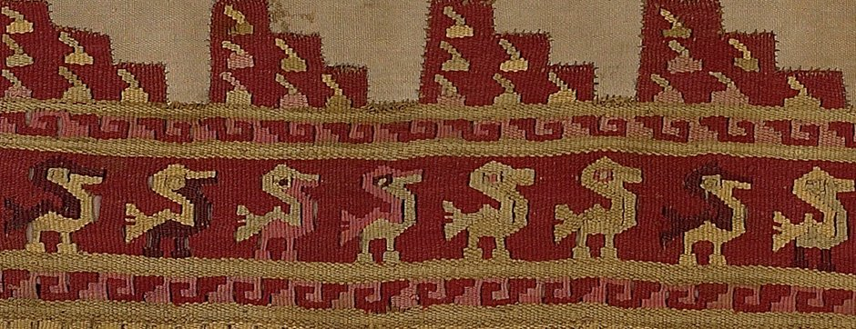 Close up of fabric pattern that appears to have red and tan duck outlines on it