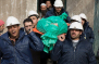 """Comrades carry Ilias Mahmoud al-Taweel, a member of Syrian Civil Defence, or White Helmets, during his funeral in in Douma, the suburbs of Damascus. A volunteer group that rescues civilians from bombed-out buildings in Syria shares this year's Right Livelihood Award, sometimes known as the """"Alternative Nobel,"""" with activists from Egypt and Russia and a Turkish newspaper."""