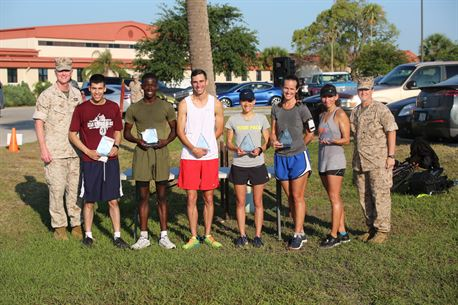 """The Marines and Sailors of Marine Corps Forces Central Command hosted a 5K, April 29, to recognize April as Sexual Assault Awareness Prevention Month.  More than 200 service members and family members ran to support fighting sexual harassment and creating awareness for bystander intervention.  Pictured left to right, Col. Brad Close, MARCENT Chief of Staff and grand marshal of the run, Army Specialist Chris Ubias (Male 3rd place: 19:59), Marine Lance Cpl.  Lenadjah White (Male 2nd place 19:18), Air Force Senior Airman Matthew Altimari (Male 1st Place: 18:16), Navy Electrician Tech 1st Class Valerie Blasewitz (Female 1st place: 22:34), Ms. Betsy Allen (Female 2nd place: 24:39), Ms. Theresa Winterhalter (Female 3rd place: 25:00), and Lt. Col. Maureen Murphy, MARCENT's senior administrative officer and event organizer. """"We were very happy to have hosted more than 200 runners to bring in the month of events on a high note,"""" said Murphy.  """"Even if just one participant from today's run steps up to prevent even one case of sexual harassment, we consider our event a huge success."""""""