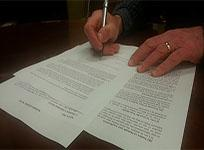 Image of legal papers being reviewed