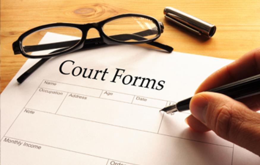 image of someone filling in a court form