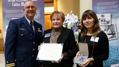 """The Muskeget weathermen legacy of 'service above self' lives on with the men and women of National Weather Service today,"" said National Weather Service Director Louis Uccellini. In this photo, Chaplain LT Larry Brant stands with relatives of posthumous Purple Heart Medal recipient Luther Brady at a ceremony in the Georgia State Capitol building in Atlanta, Dec. 13, 2016."