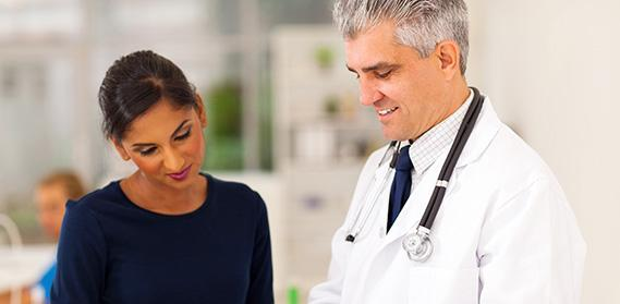 Male doctor conferring with female researcher.