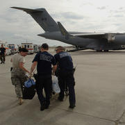 Lakefront Airport, LA - A member of the 514th Aeromedical Evacuation Squadron and two New Orleans Paramedics