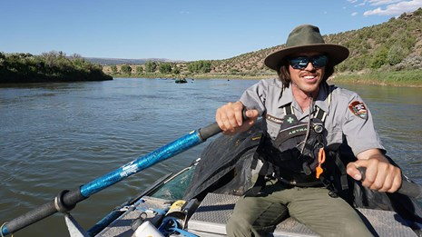 Ranger paddles down the Green River in a kayak
