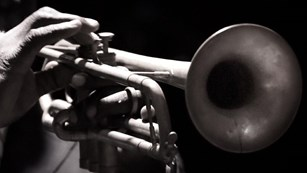 Close up of hand playing a trumpet
