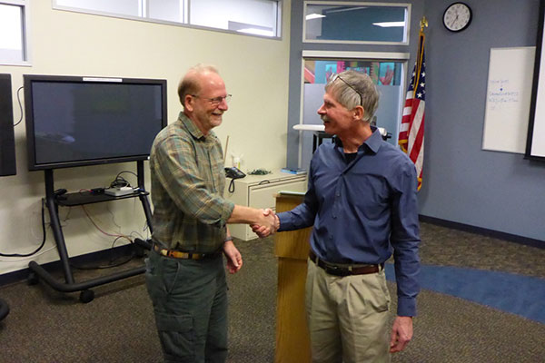 Photograph of Guy and Bob shaking hands.
