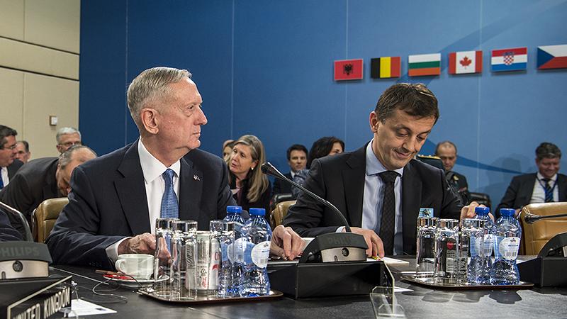 Defense Secretary Jim Mattis, left, attends a North Atlantic Council meeting at NATO Headquarters