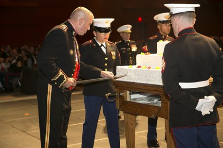 Lt. Gen. John Wissler, Commander, U.S. Marine Corps Forces Command, cuts the first piece of cake with an NCO sword during MARFORCOM's Marine Corps Birthday Ball at the Virginia Beach Convention Center in Virginia Beach, Va., Nov. 5. Marines from the Hampton Roads area gathered for the ball in honor of the Marine Corps' 241st birthday. (Official U.S. Marine Corps photo by Sgt. Kayla D. Rivera/ Released)