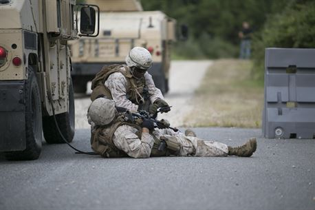Sgt. Jean Saraka, Fleet Anti-Terrorism Support Team, Marine Corps Security Force Regiment, treats a simulated casualty after opposing forces ambushed the convoy during training aboard the Naval Expeditionary Combat Center, Naval Weapons Station Yorktown, Va., Aug. 31, 2016. The Marines conducted convoy operations training to sharpen their skills when faced with real-world scenarios such as improvised explosive device threats and road block ambushes. (Official U.S. Marine Corps photo by Sgt. Calvin Shamoon/ Released)