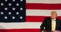 Trump with flag photo via Shutterstock