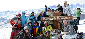 Photo of skiers on top of mountain