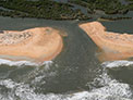 Low-altitude oblique photography taken before and after Hurricane Matthew shows the storm cut a new inlet between the Atlantic Ocean and the Matanzas River near St. Augustine, Florida